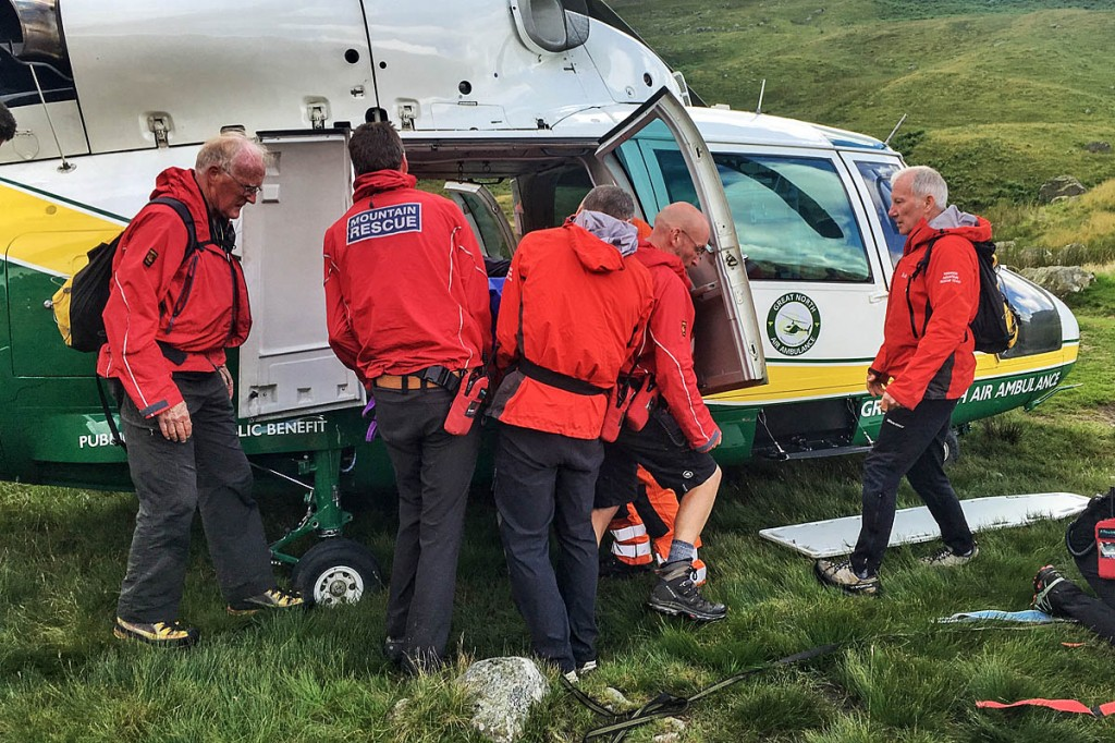 Rescuers place the injured walker in the Great North Air Ambulance aircraft. Photo: Keswick MRT