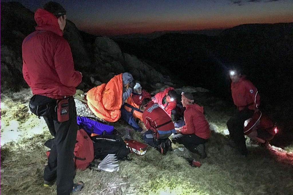 Team member attend to the injured woman. Photo: Keswick MRT