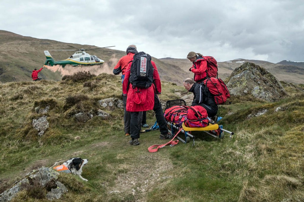 Rescuers guide in the air ambulance at the scene of the incident on High Rigg. Photo: Stuart Holmes/Keswick MRT