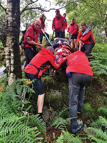 Keswick Mountain Rescue Team stretecher the injured man down the difficult descent from King's How. Photo: Keswick MRT