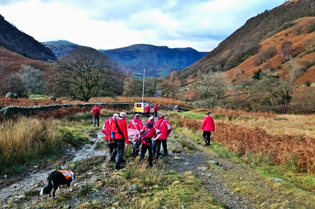 The team arrives at Fairy Glen with the injured walker. Photo: G Lloyd