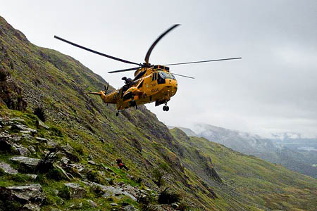 The RAF Valley winchman is lowered during the Raven Crag rescue. Photo: Keswick MRT