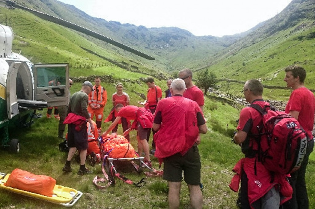 Rescuers prepare to put the walker in the air ambulance. Photo: Keswick MRT