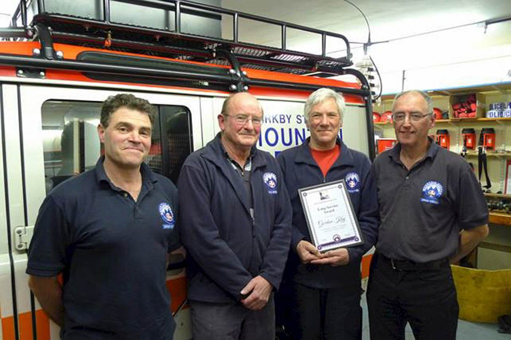Gordon Kay, second from right with, from left, team leader Adrian Cottrell, chairman Michael Sain and previous team leader Arthur Littlefair