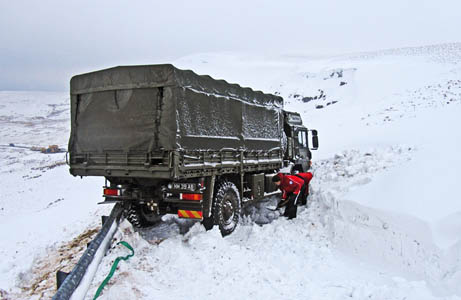 Rescuers help dig out the Army lorry. Photo: Kirkby Stephen MRT