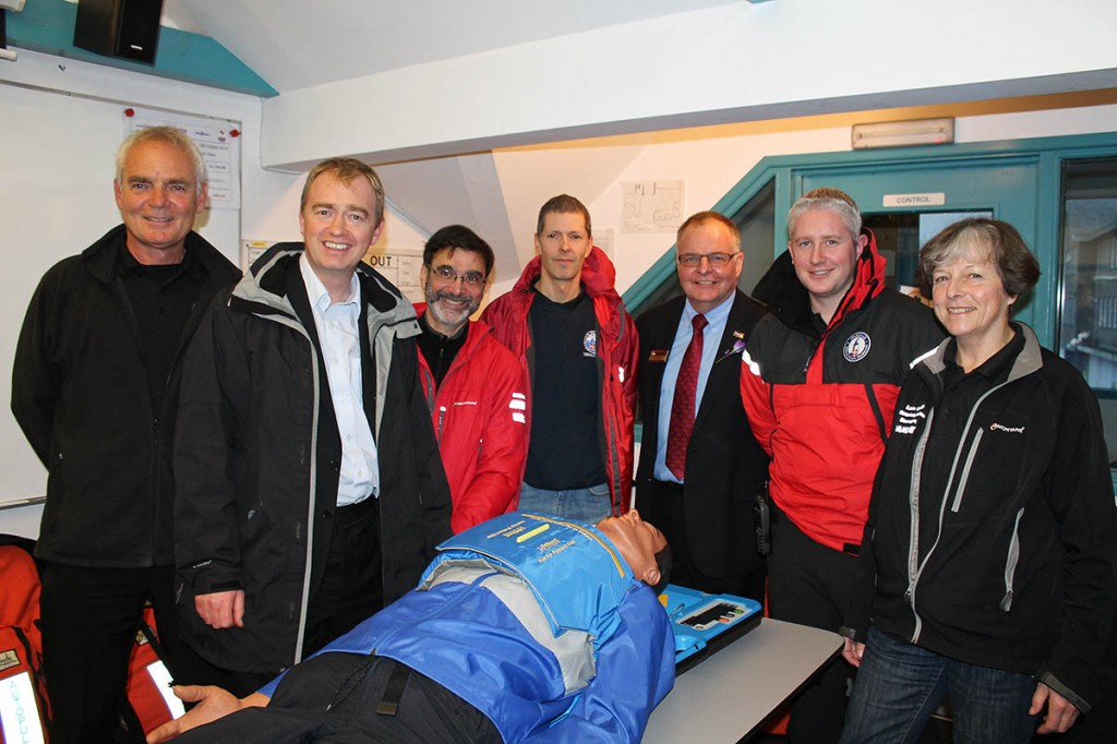 Richard Warren, left, is joined at the presentation by MP Tim Farron, second from left, Kevin Walsh, third from right, and members of Langdale Ambleside, Duddon and Furness and Wasdale teams with demonstration model Max