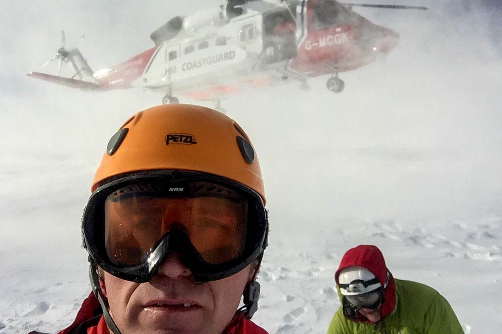 Rescuers on Glyder Fach with the Coastguard helicoper. Photo: Llanberis MRT