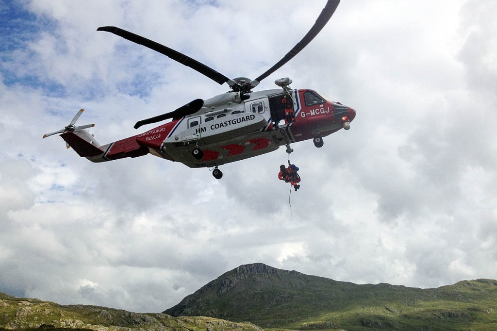 A casualty is winched into the Coastguard helicopter. Photo: Miles Hill