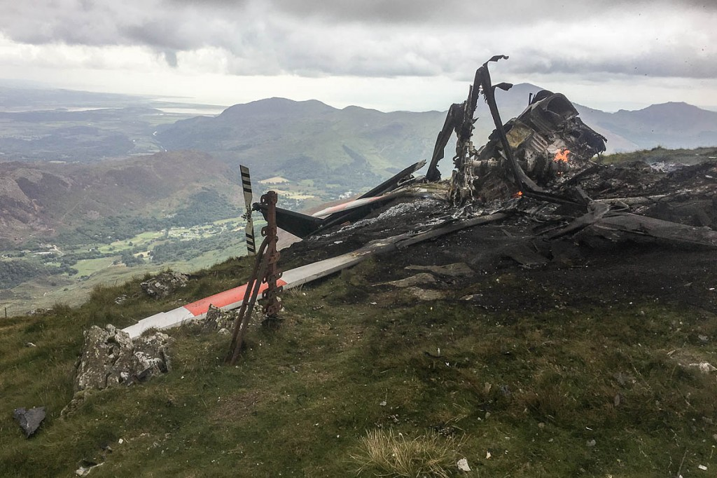 The charred remains of the aircraft on the summit of Yr Aran. Photo: Llanberis MRT