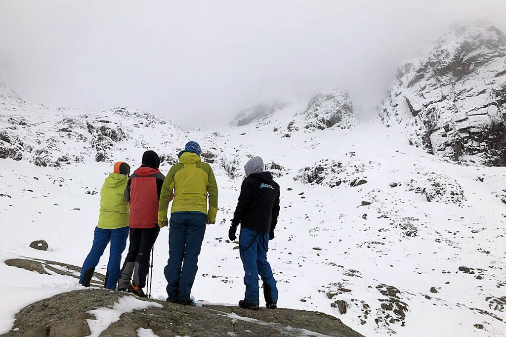 The climber's relatives and a friend look at the scene on Ben Nevis. Photo: Lochaber MRT
