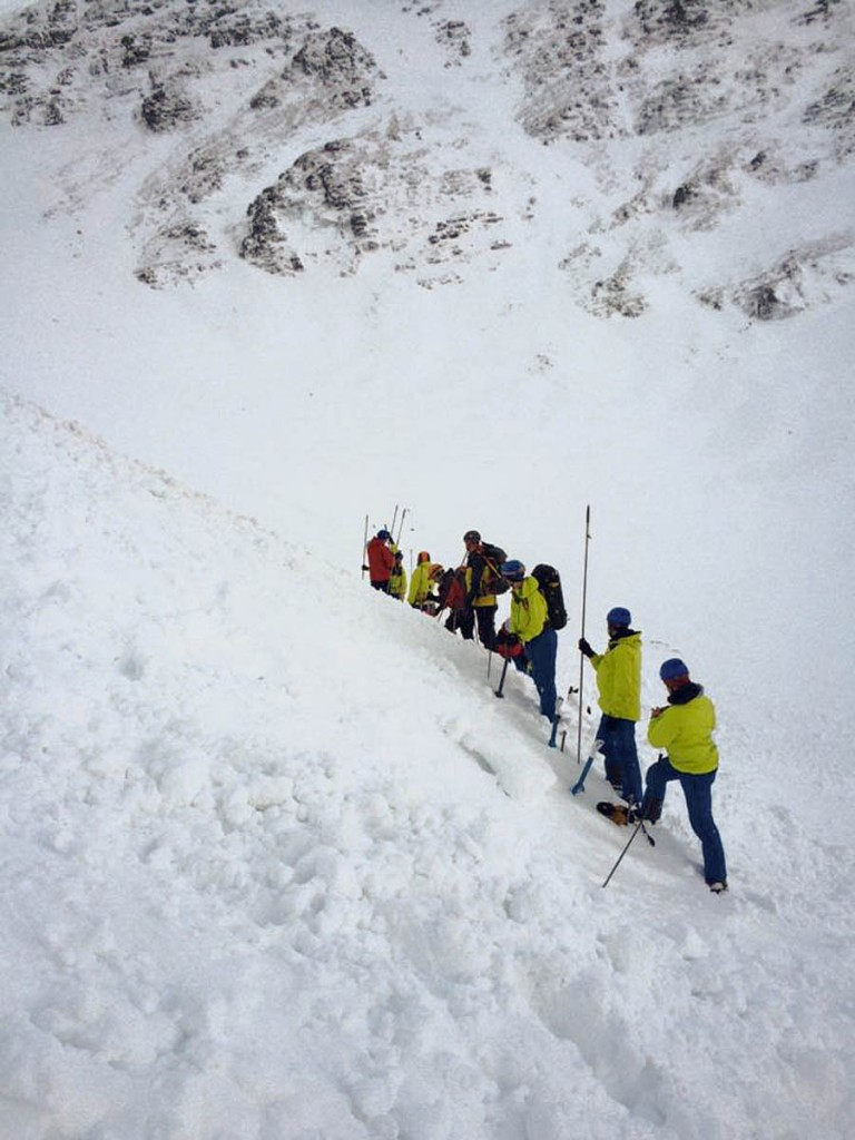 Rescuers probe avalanche debris on Creag Meagaidh during Wednesday's incident. Photo: Lochaber MRT