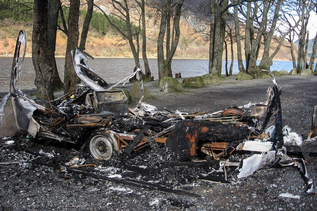 A burnt-out caravan on the shore of Loch Lubnaig. Photo: Loch Lomond and the Trossachs NPA