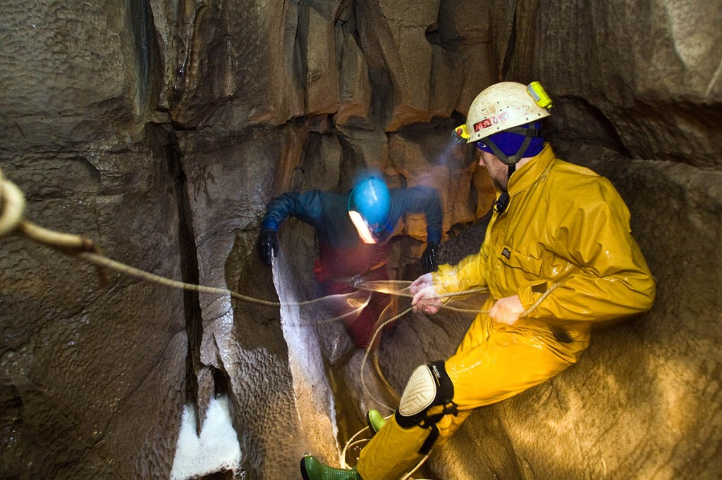 Cavers with standard safety equipment in Long Churn Cave