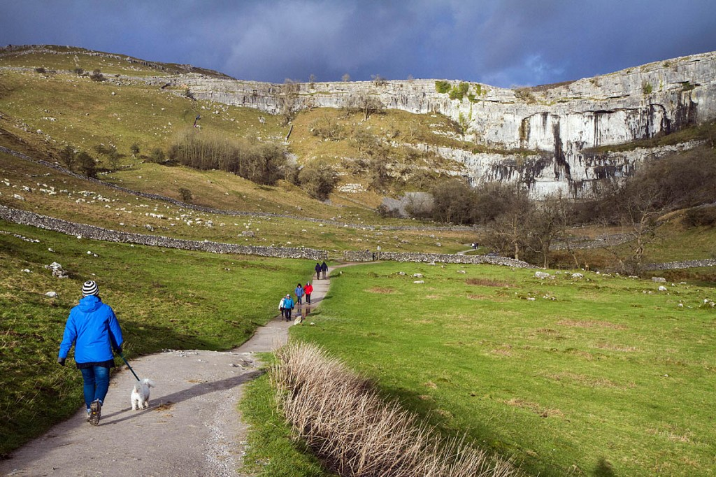 The woman slipped near the top of Malham Cove, the 80m limestone crag in the Yorkshire Dales