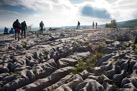 The walker slipped on the limestone pavement above Malham Cove