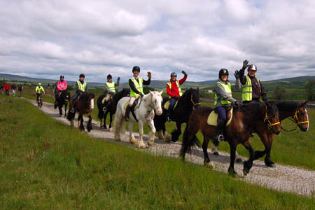 Martin Clunes and Alison Roper, local horse riding leader, with members of the BHS
