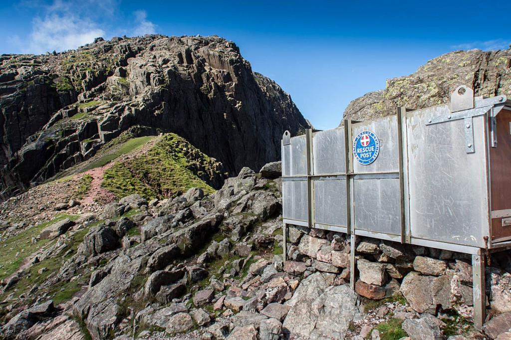 The mountain rescue stretcher box at Mickledore, with Broad Stand and Scafell in the distance