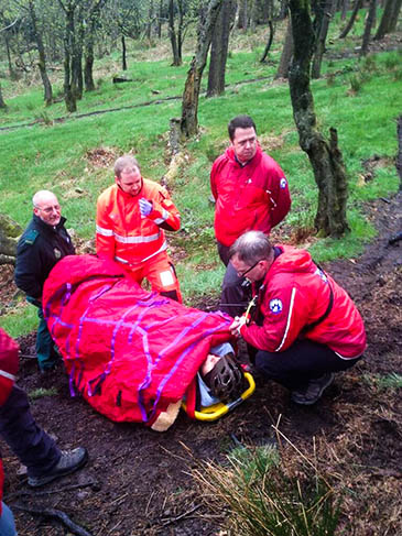 Rescuers at the scene of a mountain bike crash