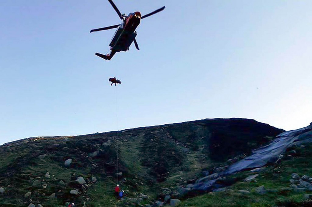 The injured man is winched into the Irish Coastguard helicopter. Photo: Mourne MRT