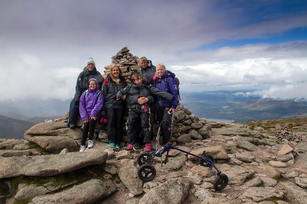 Natasha Lambert on the summit of Cairn Gorm with support team, including Heather Morning, right