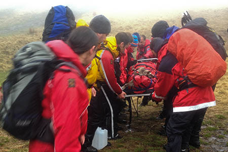 Rescuers prepare to stretcher the injured walker from the Neuadd Ridge. Photo: Ryan Atkinson