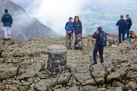 Summiteers pose on Ben Nevis, top of the list for British baggers
