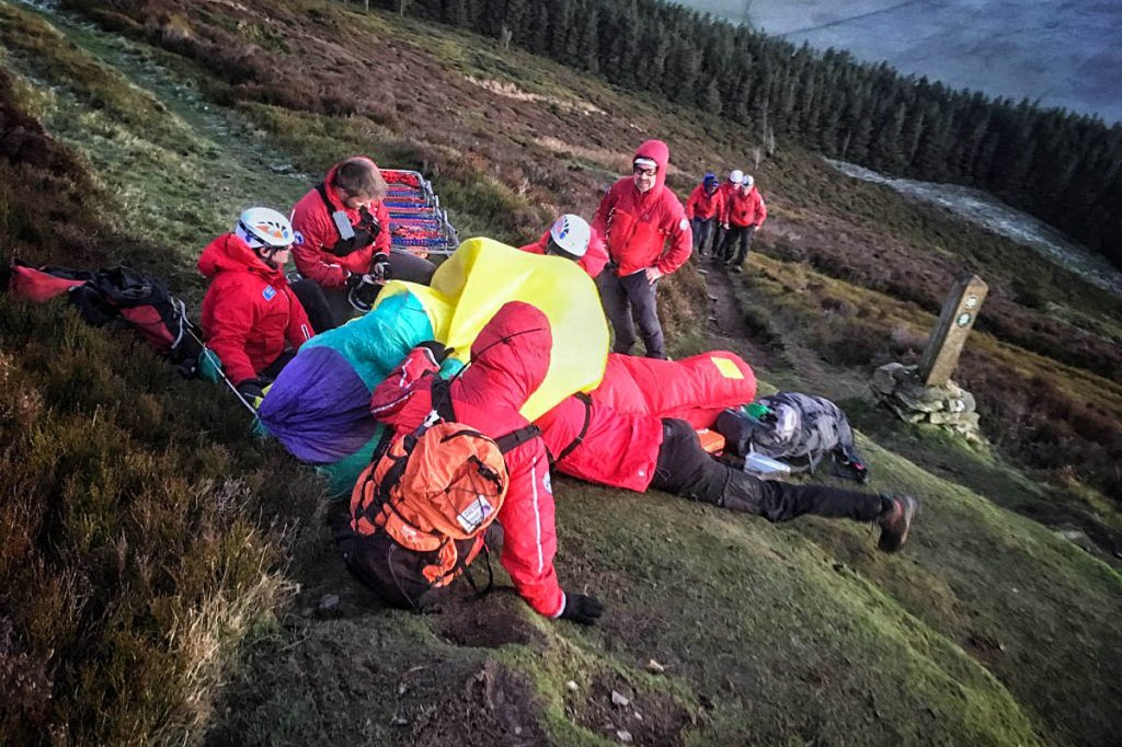 Rescue team members treat the injured walker on Foel Fenlli. Photo: Newsar