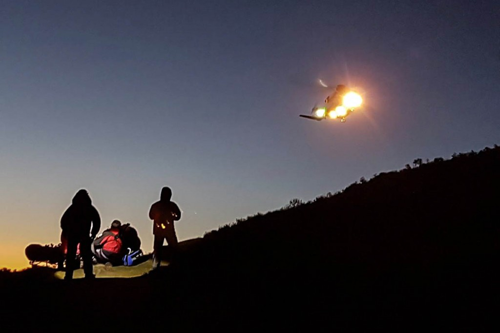 The Coastguard helicopter at the scene. Photo: Newsar