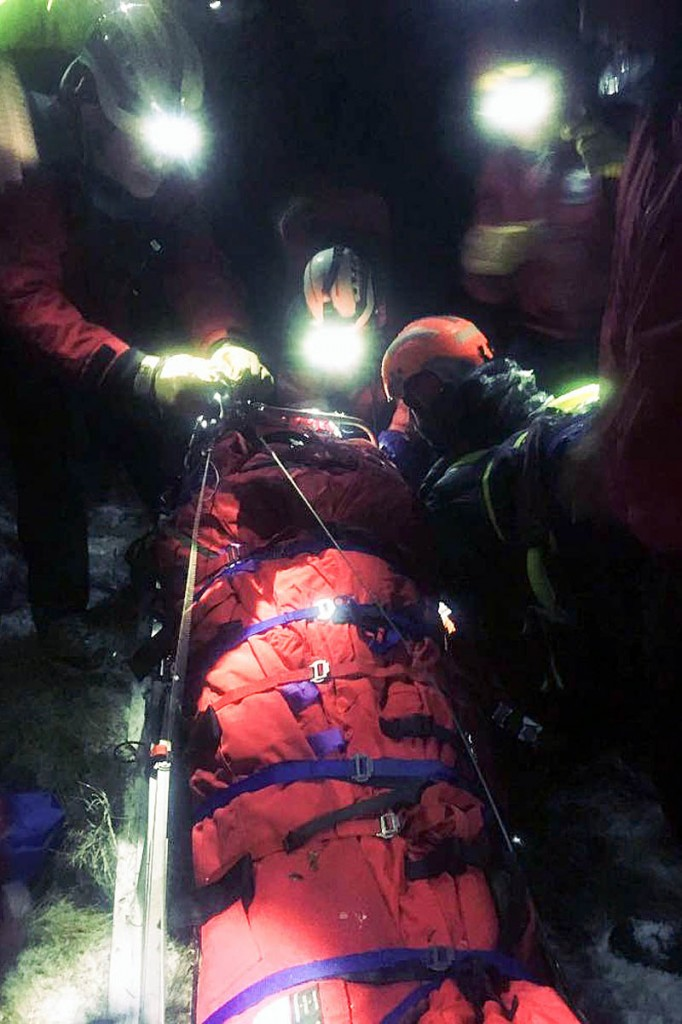 The pilot was secured in a mountain rescue stretcher. Photo: NNPMRT