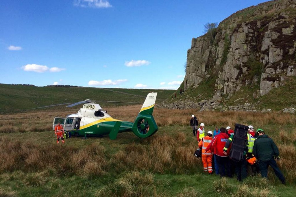 The climber is stretchered to the helicopter. Photo: Northumberland NPMRT