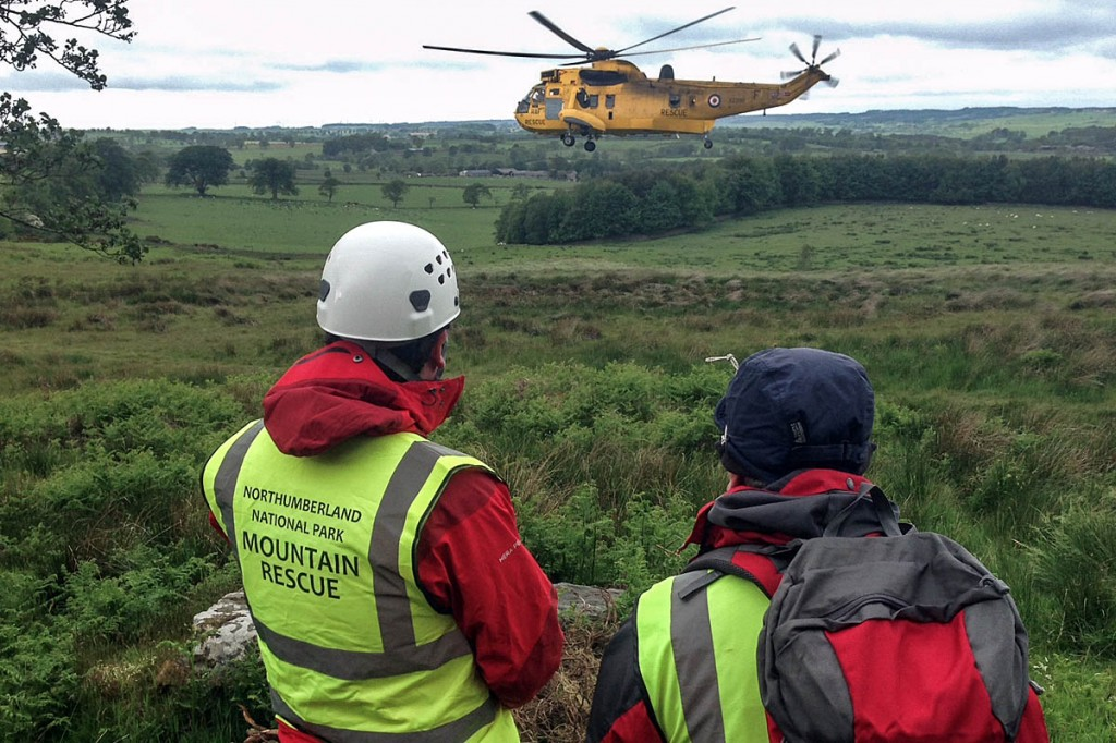 Rescuers look on as the man is airlifted from the site by the Sea King. Photo: Northumberland NPMRT