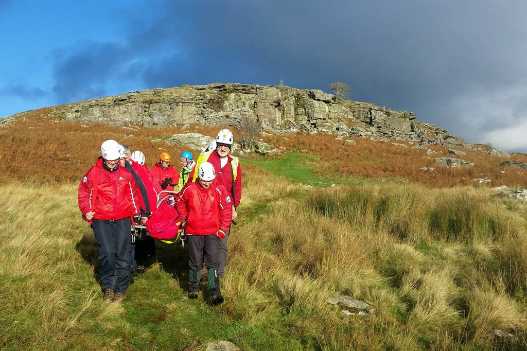 The climber is stretchered from the crag by rescue team members. Photo: Northumberland National Park MRT