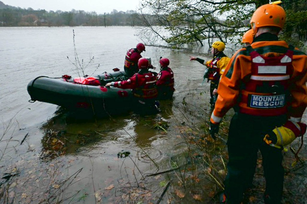 Rescuers with the boat at the flooded site. Photo: Northumberland NPMRT