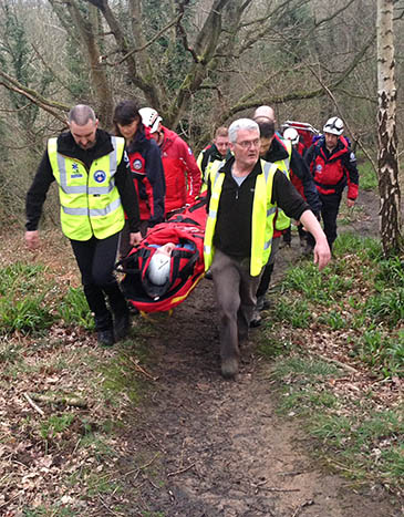 North of Tyne and Northumberland National Park MRT members stretcher the walker from Plessey Woods