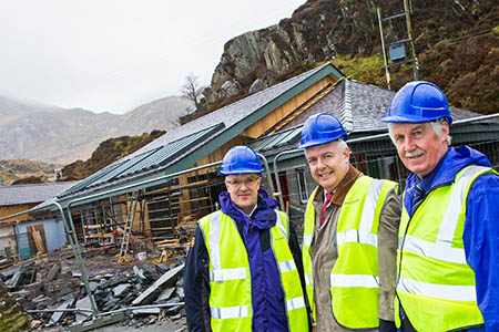 National park authority chief executive Aneurin Phillips, First Minister Carwyn Jones and authority chair Caerwyn Roberts in front of the building work at Ogwen.Photo: Alan Dop