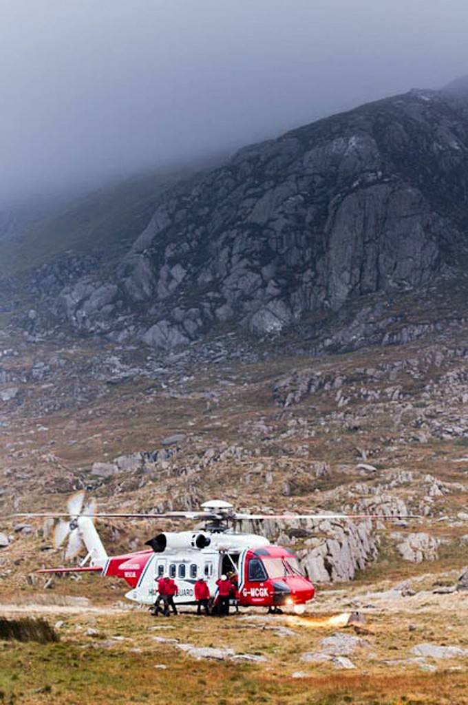 Rescuers and the Coastguard helicopter at the scene during the incident. Photo: Mike Gibson/m@mprojectman.co.uk