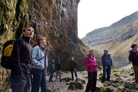 HF Holidays walk leader Andy Hauser, left, with members of the OIA at Gordale Scar
