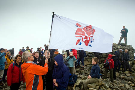 Richard Warren of Wasdale Mountain Rescue Team raises the Olympic flag on England's highest peak, Scafell Pike. Luckily, Team Wayne didn't need the MRT's services