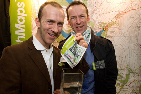John Overton demonstrates the water-friendly attributes of the maps, while his brother David Overton wears one of the SplashMaps
