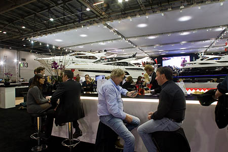 Across the way, visitors enjoy their champagne at the boat show, where the seriously expensive gear is
