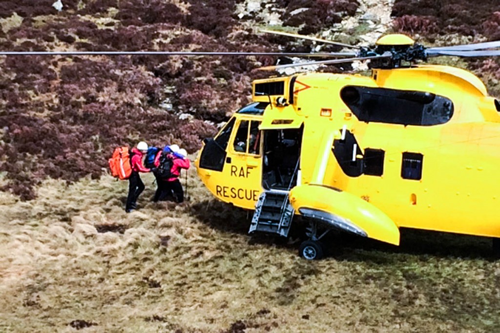 The walker is helped to the helicopter on Moel Siabod today. Photo: OVMRO