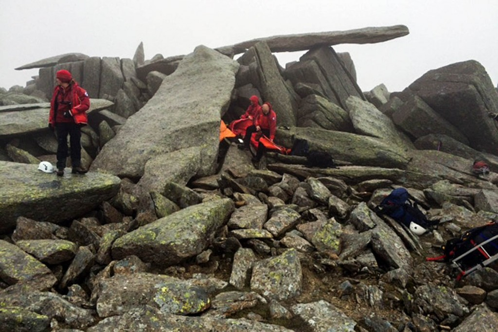 Rescuers at the scene where the injured man and his companions took shelter near the Cantilever Stone. Photo: OVMRO