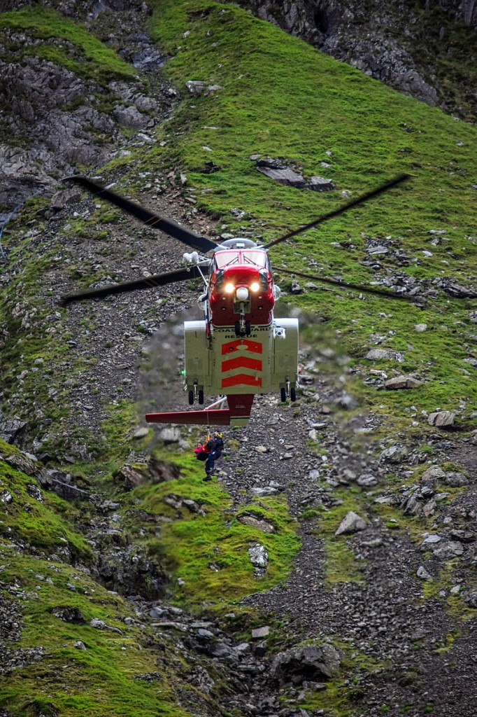 The woman is winched into the Coastguard helicopter in Cwm Idwal. Photo: John Carrie