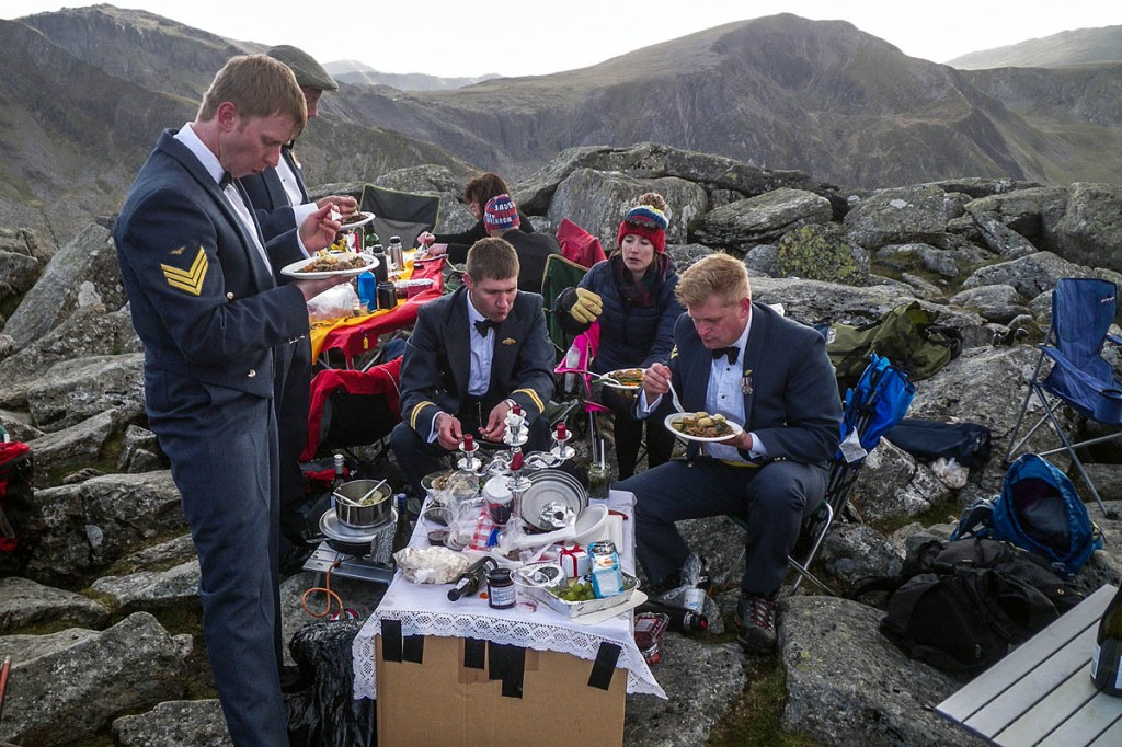 RAF crew members and rescue team volunteers enjoy their mountain-top dinner. Photo: OVMRO