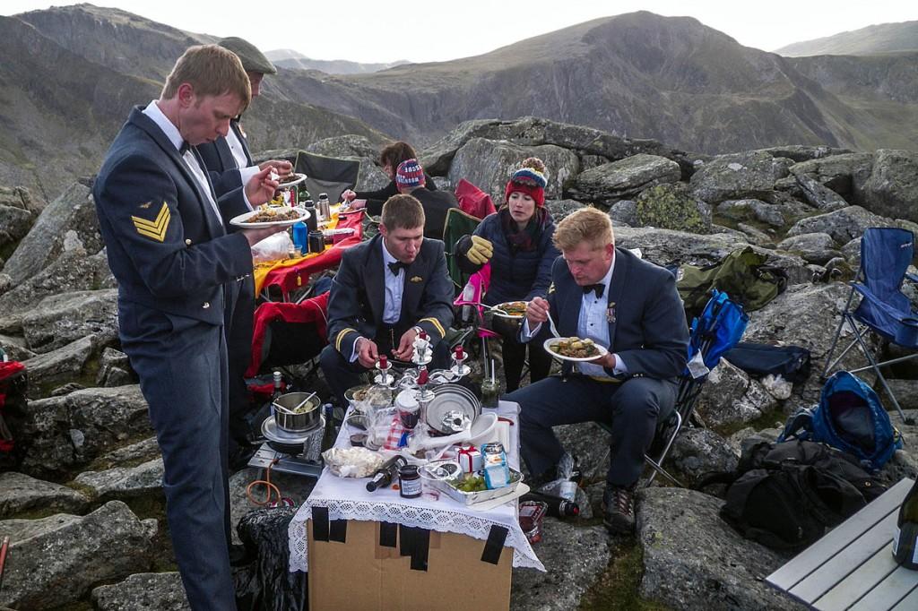 RAF crew members and rescue team volunteers enjoy their mountain-top dinner. Photo: OVMRO