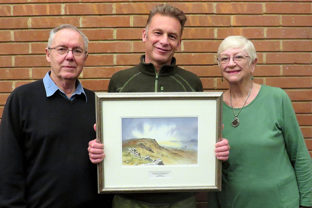 Chris Packham, centre, received his award from Peter and Leni Gillman