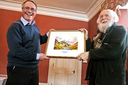 Dr Adam Watson, right, receives the OWPG's Golden Eagle Award from guild chairman Jonathan Williams