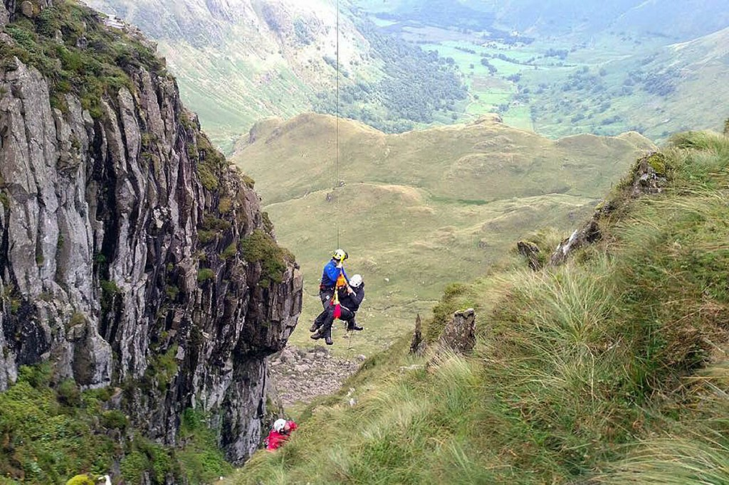 The walker is winched into the Coastguard helicopter from the gully. Photo: Patterdale MRT