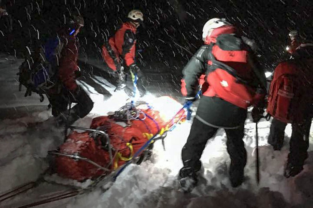 Rescuers sledge the injured snowboarder from the mountain. Photo: Patterdale MRT