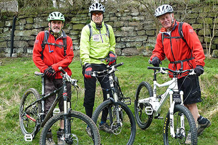Peak District national park rangers Martyn Sharp, Terry Male and Terry Page prepare to go out on mountain bike patrol